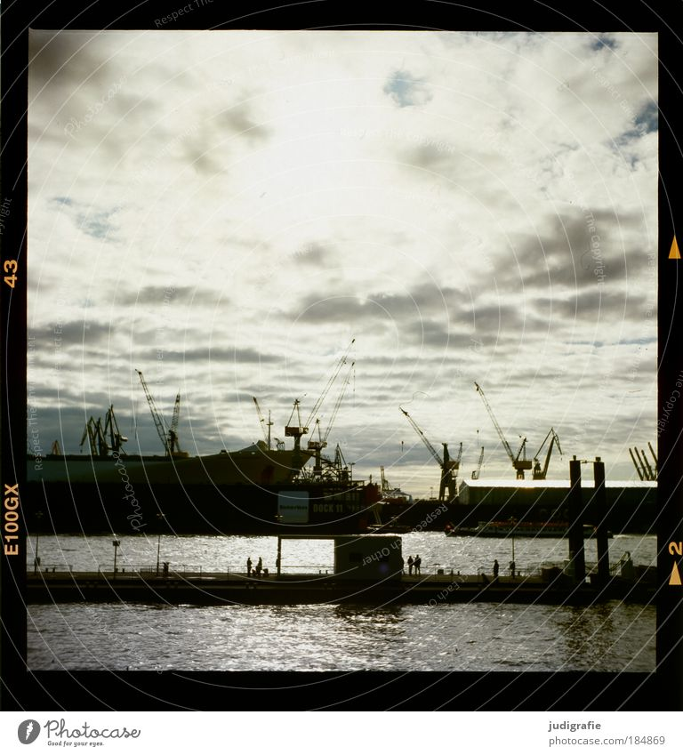 HAMBURG Colour photo Exterior shot Back-light Human being Sky Clouds Hamburg Town Harbour Navigation Inland navigation Container ship Dark Moody Tourism Economy
