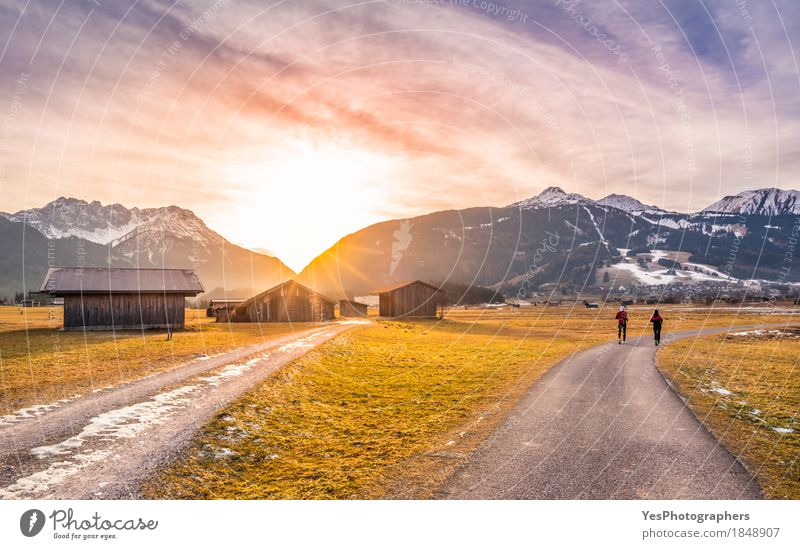 Winter sunset over alpine country roads Life Relaxation Calm Vacation & Travel Tourism Trip Freedom Sun Snow Mountain Christmas & Advent Sports Nature Landscape