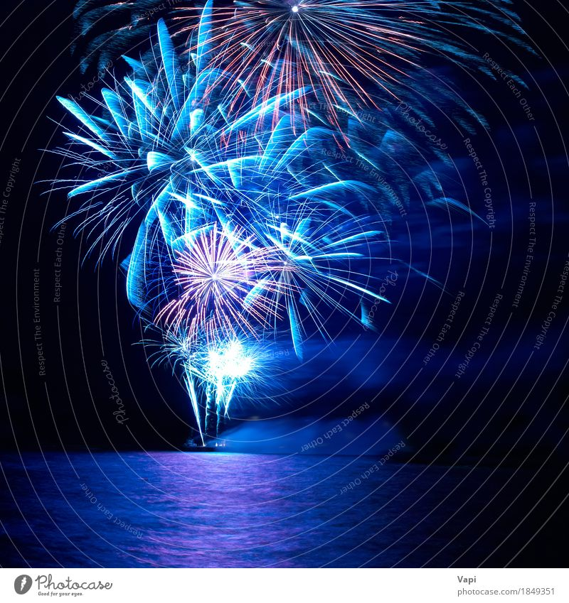 Blue and red colorful holiday fireworks Joy Night life Entertainment Party Event Feasts & Celebrations Christmas & Advent New Year's Eve Water Sky Night sky Bay
