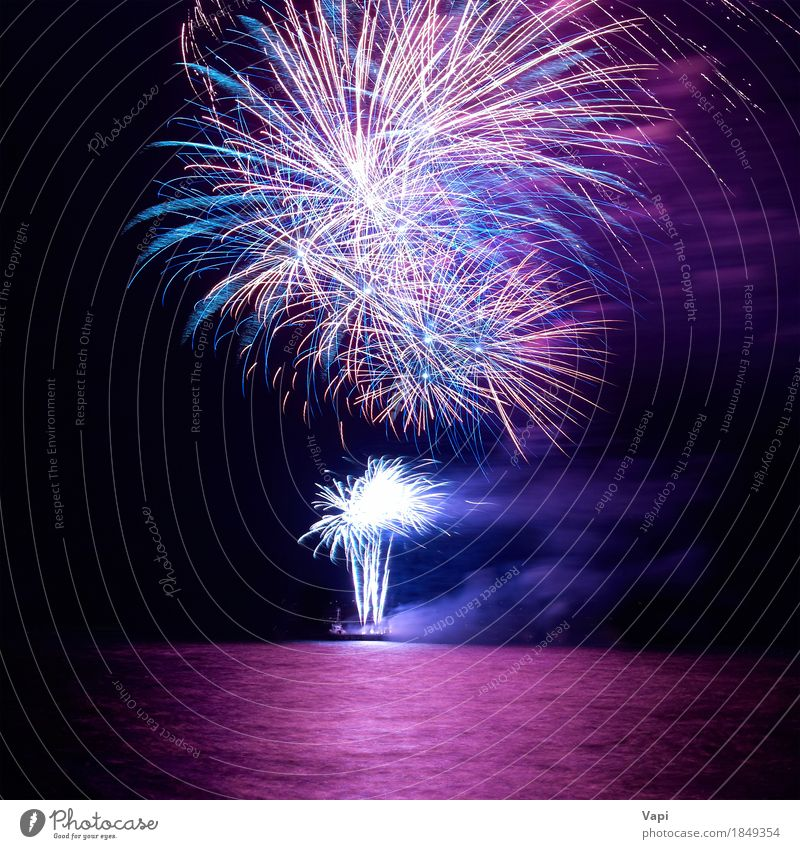 Blue and red colorful holiday fireworks Sky Christmas & Advent Colour White Red Joy Dark Black Yellow Feasts & Celebrations Party Pink Bright Violet New