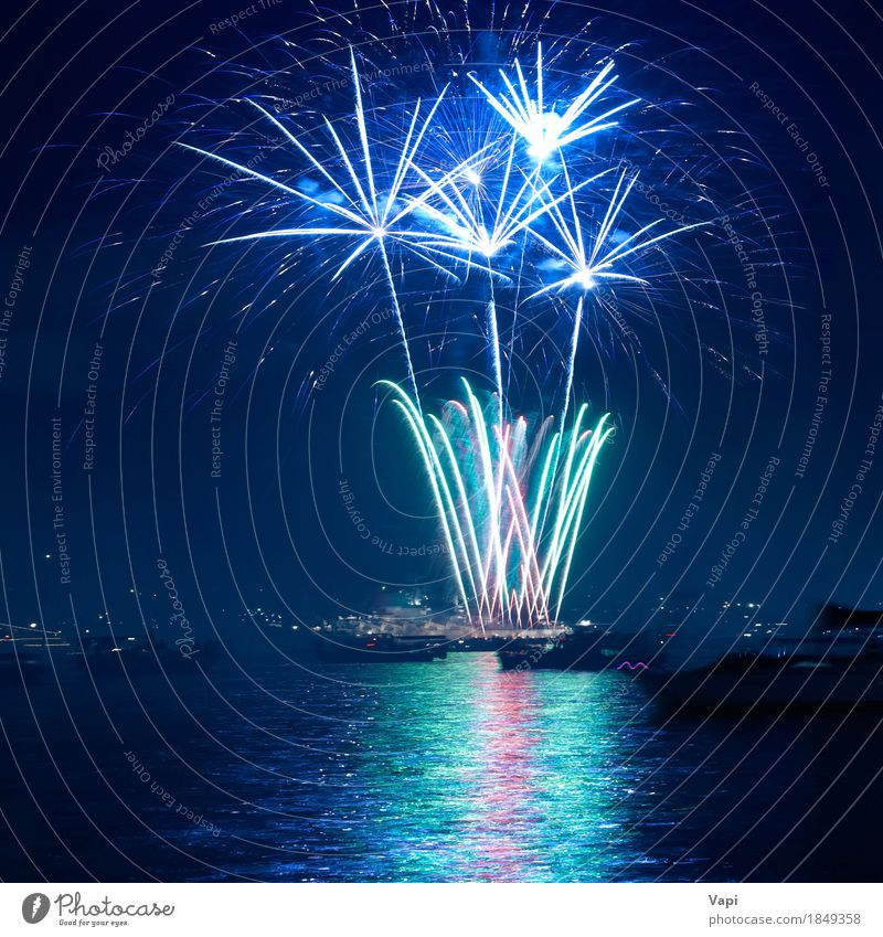 Colorful fireworks above a lake Sky Blue Christmas & Advent Colour Green White Red Joy Dark Black Yellow Art Freedom Feasts & Celebrations Party Bright