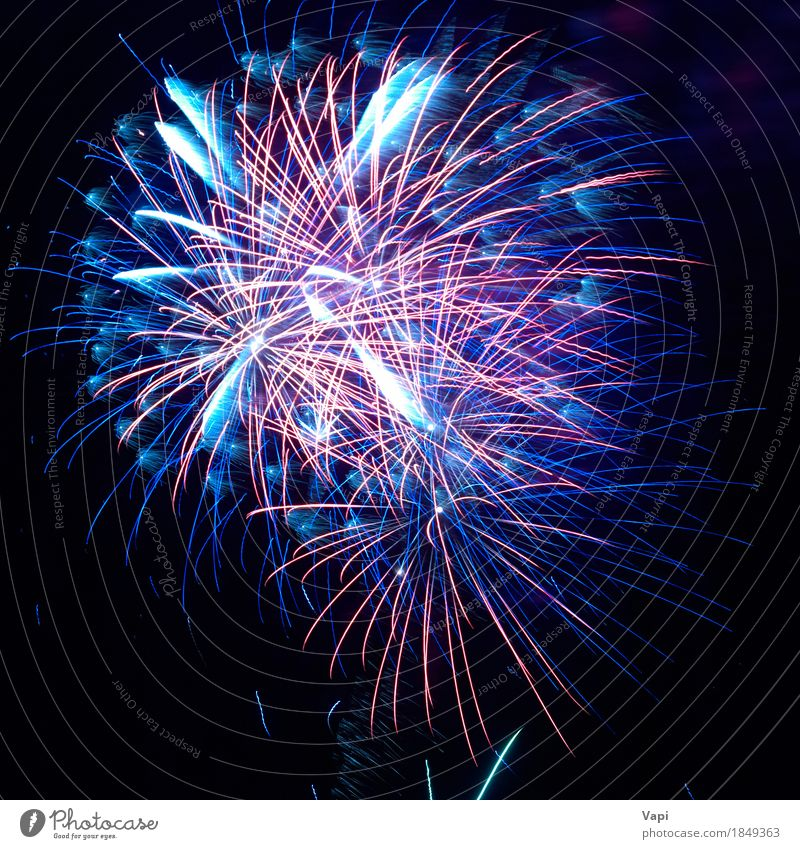 Blue and red colorful holiday fireworks Joy Night life Entertainment Party Event Feasts & Celebrations Christmas & Advent New Year's Eve Sky Night sky Dark