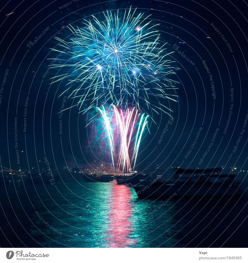Colorful fireworks above a lake Joy Freedom Night life Entertainment Party Event Feasts & Celebrations Christmas & Advent New Year's Eve Art Water Sky Night sky