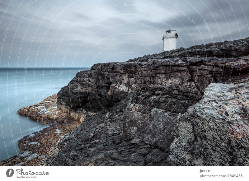 Pan-pan Landscape Sky Clouds Horizon Rock Coast Ireland Tower Lighthouse Gloomy Blue Brown Gray White Calm Safety Colour photo Subdued colour Exterior shot