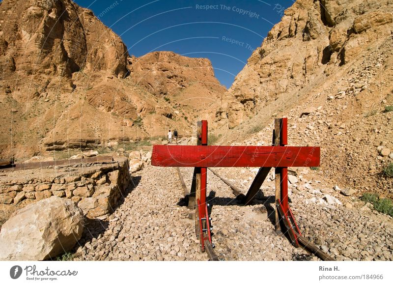 Human being Nature Blue Red Far-off places Mountain Landscape Sand Lanes & trails Stone Fear Earth Going Rock Dangerous Threat