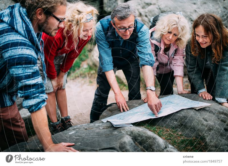 Group of Hikers checking route on map in the mountains Woman Vacation & Travel Youth (Young adults) Man Relaxation Joy 18 - 30 years Mountain Adults Senior citizen Lifestyle Sports Family & Relations Group Rock Tourism