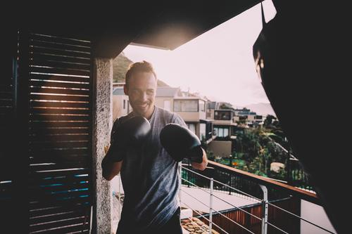 Young Adult doing Boxing workout on balcony at home Lifestyle Joy Body Athletic Fitness Leisure and hobbies Summer Living or residing Flat (apartment)