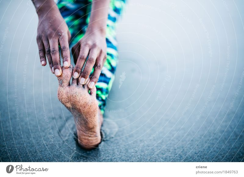 Close-up of Women stretching legs and Toes at beach Lifestyle Personal hygiene Body Athletic Fitness Wellness Meditation Leisure and hobbies Beach Yoga Woman