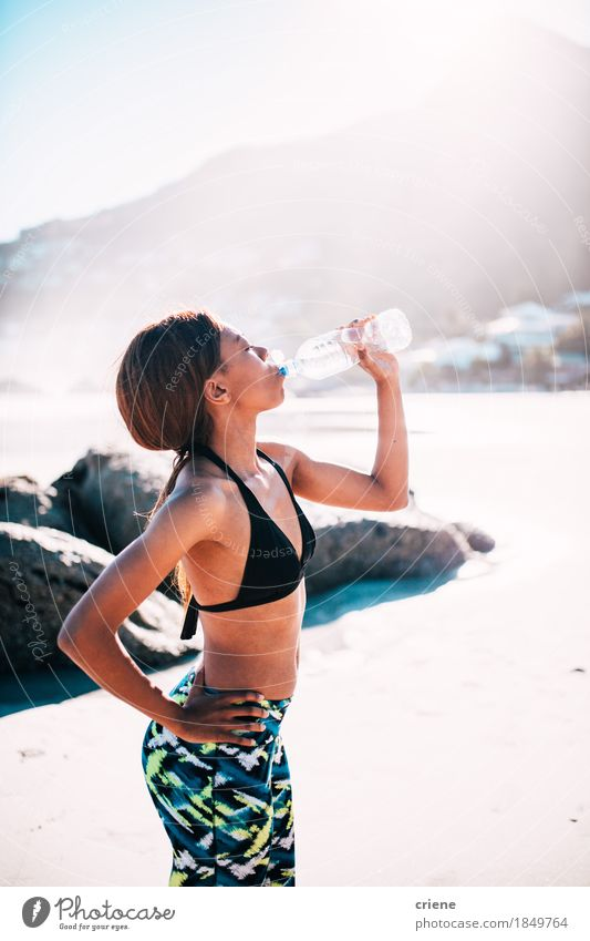 African Women drinking Water out of a bottle Drinking Lifestyle Personal hygiene Body Health care Athletic Fitness Wellness Summer Sun Beach Sports