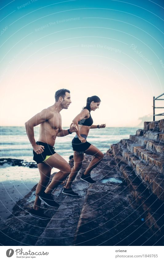 Two young adult athletes doing running exercise Youth (Young adults) Summer Beach Lifestyle Sports Health care Couple Together Body Fitness Wellness Athletic Running Relationship Musculature Flexible