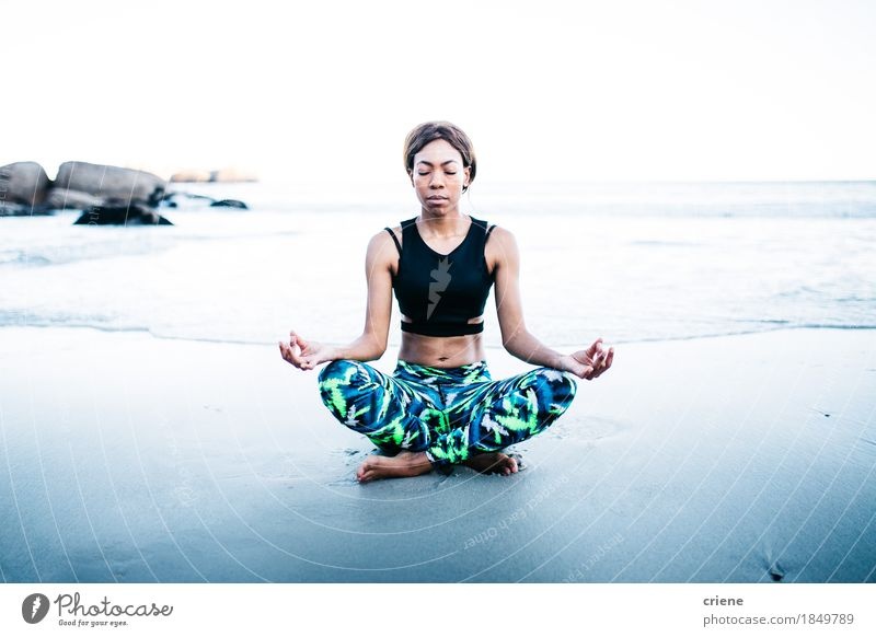 Afro American young women doing Meditation on beach Youth (Young adults) Beautiful Young woman Ocean Relaxation Joy Beach Lifestyle Sports Health care Sand Leisure and hobbies Waves Body To enjoy Fitness