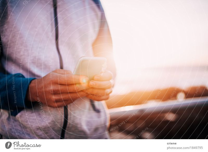 Close-up of men using smart phone outdoor with copy space Human being Youth (Young adults) Man Young man Hand Adults Life Lifestyle Business Technology Telecommunications Fingers Reading Telephone Internet Cellphone