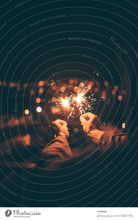 Man holding sparkler in hands celebrating new years eve Human being Hand Joy Lifestyle Happy Feasts & Celebrations Party Event New Year's Eve Night life