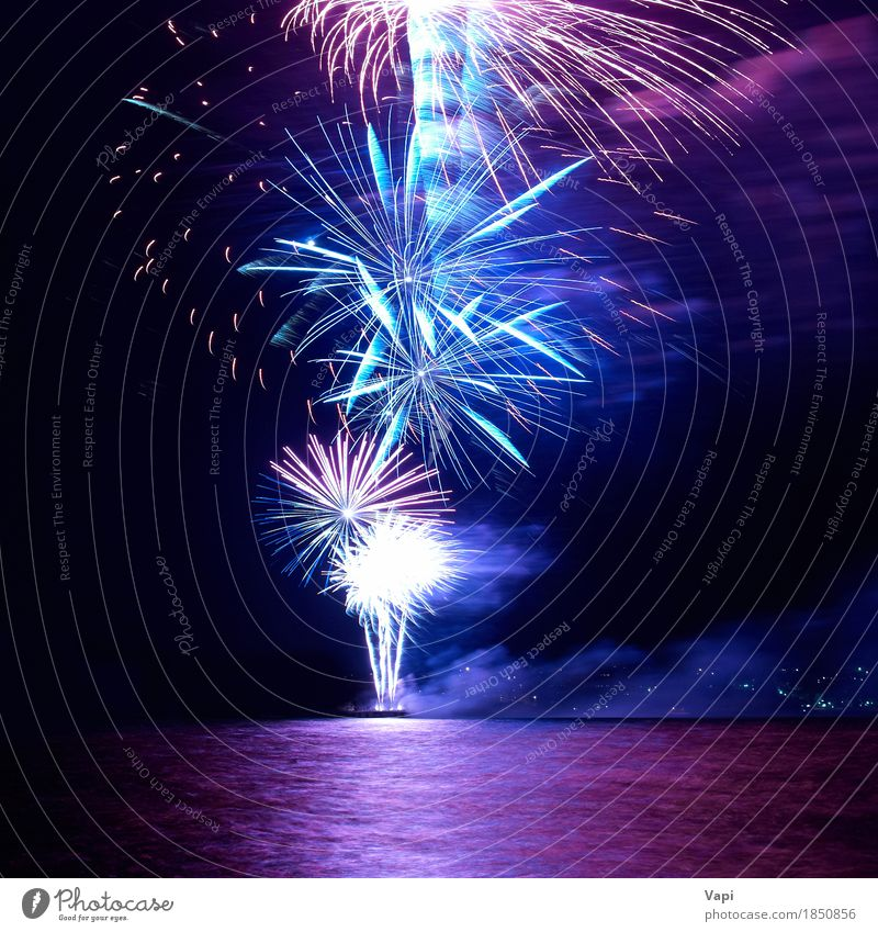Blue and red colorful holiday fireworks Sky Blue Christmas & Advent Colour Water White Red Joy Dark Black Yellow Feasts & Celebrations Party Lake Pink Bright