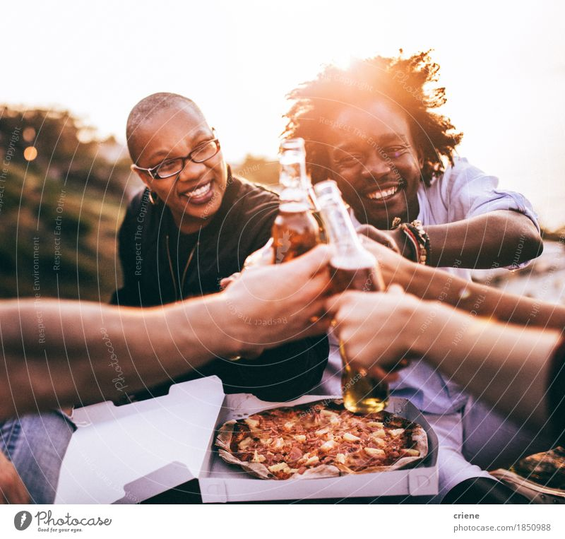 Multi Ethnic Group of friends enjoying drinks and pizza Human being Youth (Young adults) Summer Young woman Sun Young man Relaxation Joy 18 - 30 years Adults Eating Lifestyle Feminine Food Freedom Feasts & Celebrations