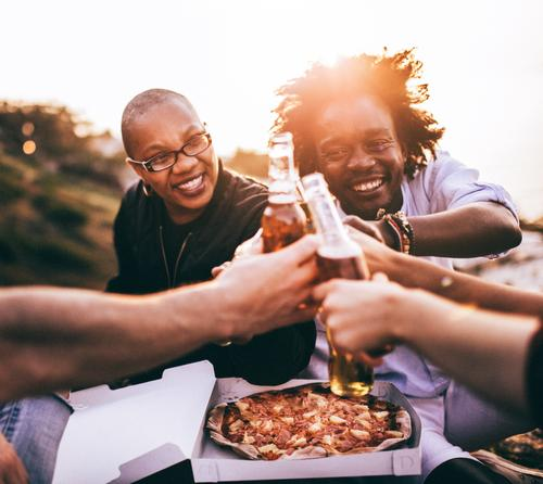 Multi Ethnic Group of friends enjoying drinks and pizza Food Eating Lunch Dinner Beverage Drinking Cold drink Alcoholic drinks Beer Bottle Lifestyle Joy