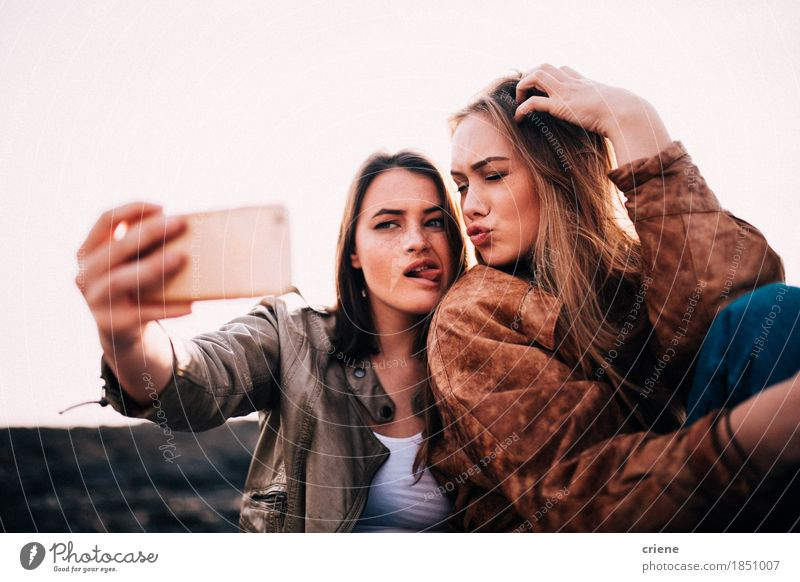 Teenager Girls taking selfie with smartphone Vacation & Travel Youth (Young adults) Young woman Joy Funny Laughter Couple Together Friendship Blonde Technology Crazy Happiness Telephone Posture Camera