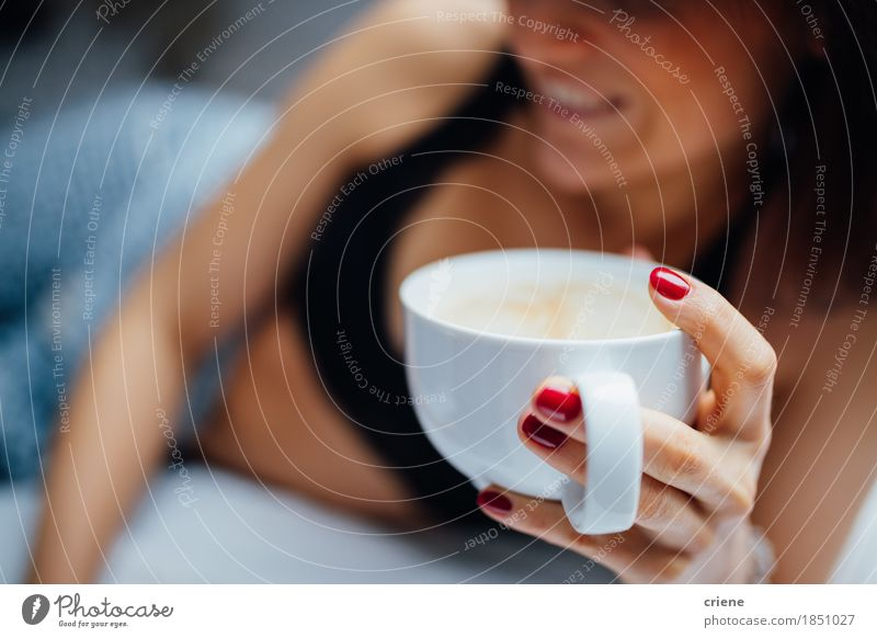 Close-up of women holding fresh cup of coffee in bed in morning Human being Youth (Young adults) Young woman Relaxation Joy Adults Warmth Lifestyle Living or residing Sit Smiling Sleep Beverage Coffee Hot Home