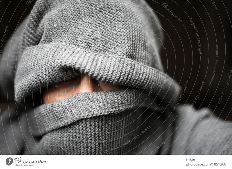 grey figure Human being Woman Adults Man Life Head Face 1 Scarf Cap Knitted Threat Dark Masked Wrapped in Gray Woolen hat Dark background Concealed Mysterious