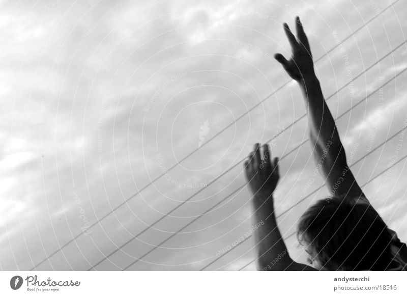 I Can Reach The Sky Fingers Playing Jump Bad weather Clouds Man Arm Traffic infrastructure Catch hands Head Black & white photo grab Evening