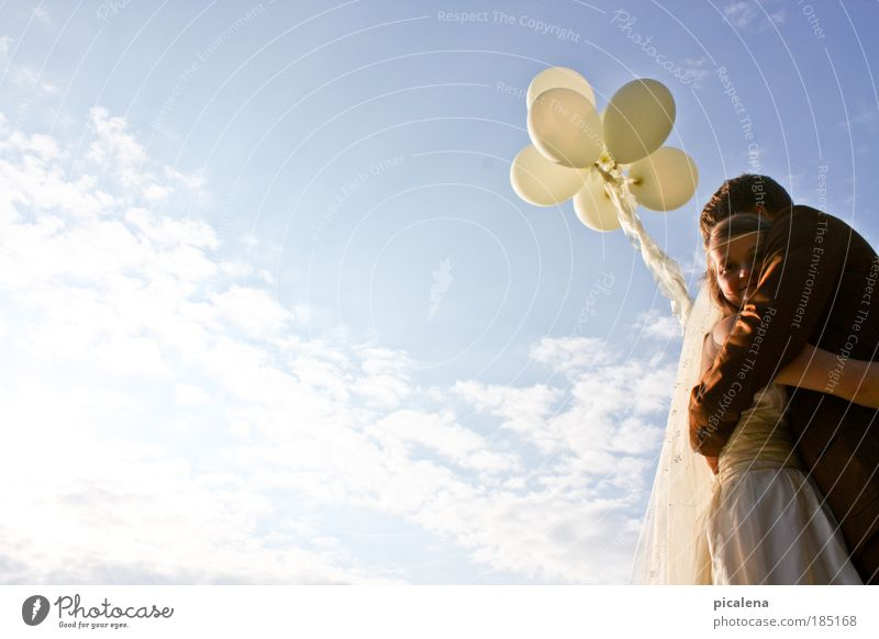 on cloud 7 Couple 2 Human being 18 - 30 years Youth (Young adults) Adults Sky Beautiful weather Bridal veil Balloon Embrace Fresh Happy Positive Emotions Safety
