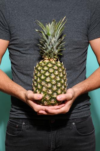 Pineapple hold I Food Fruit Nutrition Style Design Exotic Healthy Wellness Life Industry Trade Advertising Industry Company Masculine Young man