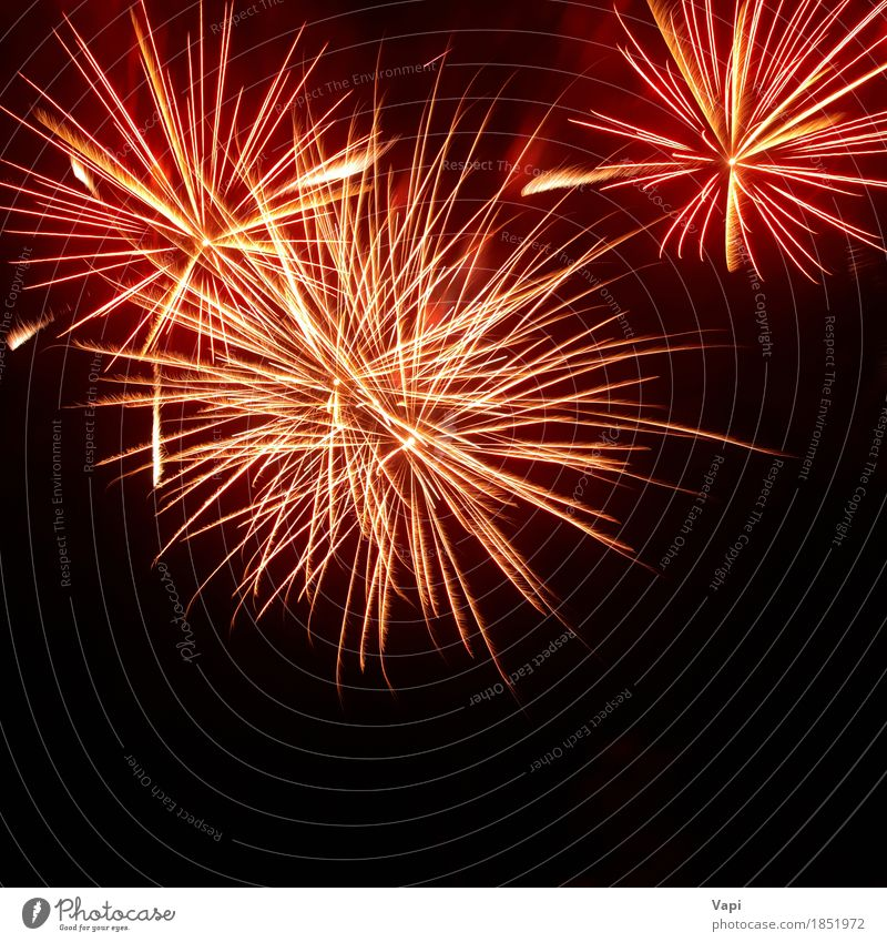 Colorful red and orange fireworks on the black sky Sky Christmas & Advent Colour White Red Joy Dark Black Yellow Art Feasts & Celebrations Party Orange Design