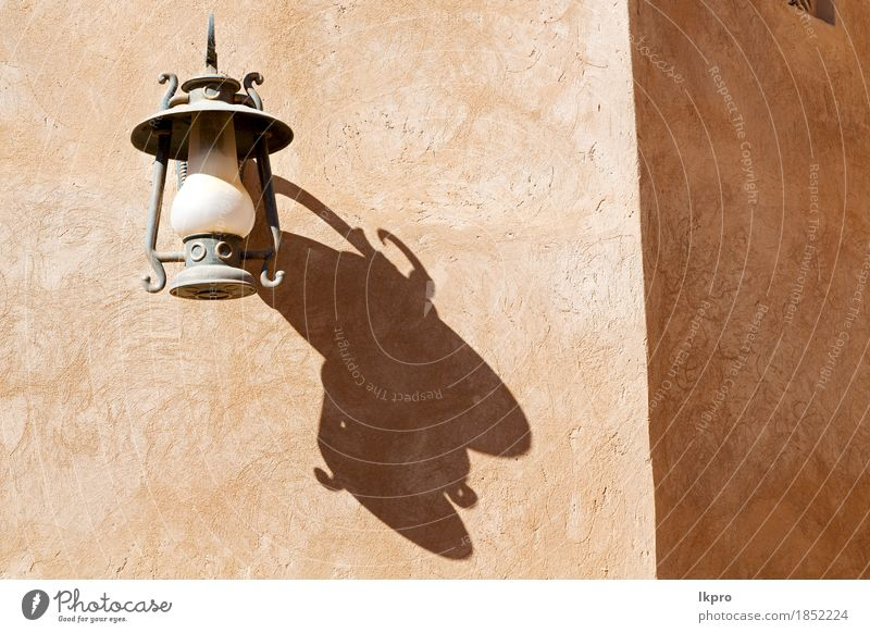 in oman the street lamp in a old wall Vacation & Travel Old City White Black Street Architecture Style Building Lamp Gray Design Metal Decoration Retro Culture