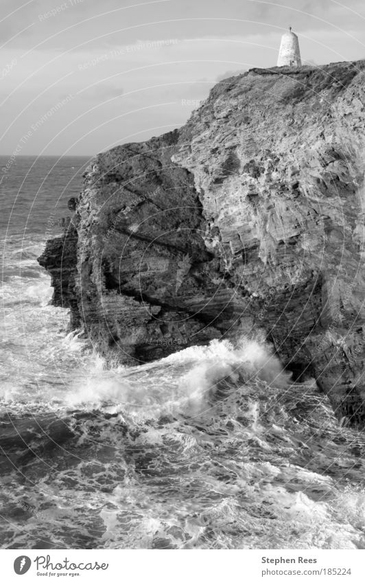Cliffs and the Pepperpot Daymark in Portreath Old Sky White Ocean Black Clouds Stone Waves Coast England Atlantic Ocean Monochrome Rough Erosion British