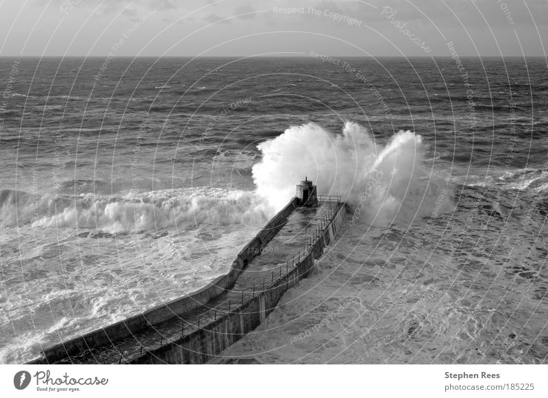 Big Atlantic wave breaks on Portreath pier. Nature Sky White Ocean Winter Black Landscape Waves Coast Weather Horizon Human being Jetty To break (something)