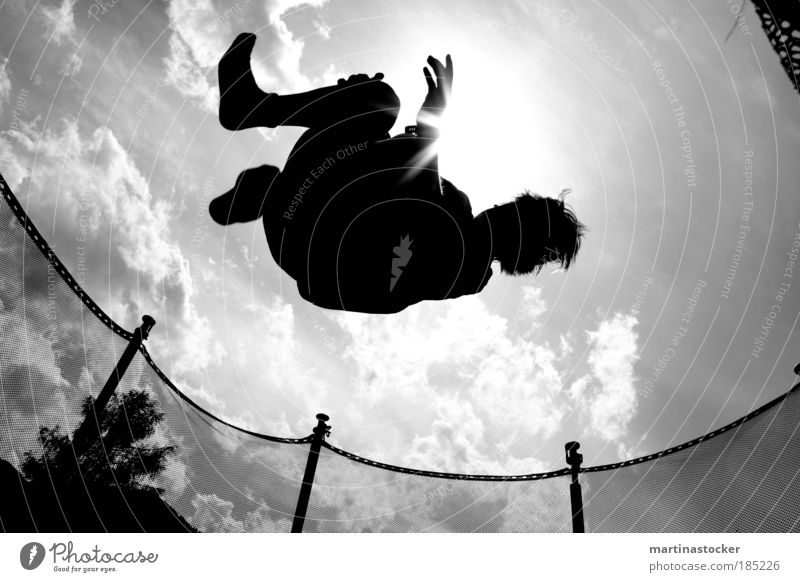 trampoline jump Masculine Young man Youth (Young adults) Life Air Sky Clouds Sun Sunlight Summer Beautiful weather Tree Hair and hairstyles Flying Jump