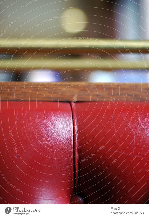 Red Knobbel Living or residing Flat (apartment) Arrange Interior design Sofa Armchair Chair Leather Varnish Metal Gold Old Kitsch Soft Elegant Nostalgia Wood