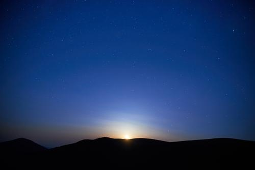 Blue dark night at the mountains and sky with many stars Vacation & Travel Tourism Adventure Sun Mountain Hiking Environment Nature Landscape Sky Clouds