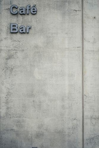 Town Wall (building) Wall (barrier) Gray Characters Signs and labeling Concrete Café Bar Lettering