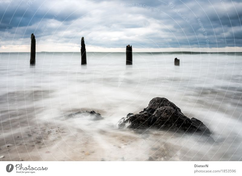 ravages of time Environment Landscape Water Sky Clouds Weather Bad weather Wind Blue Black White Break water Wood Waves White crest Horizon Colour photo