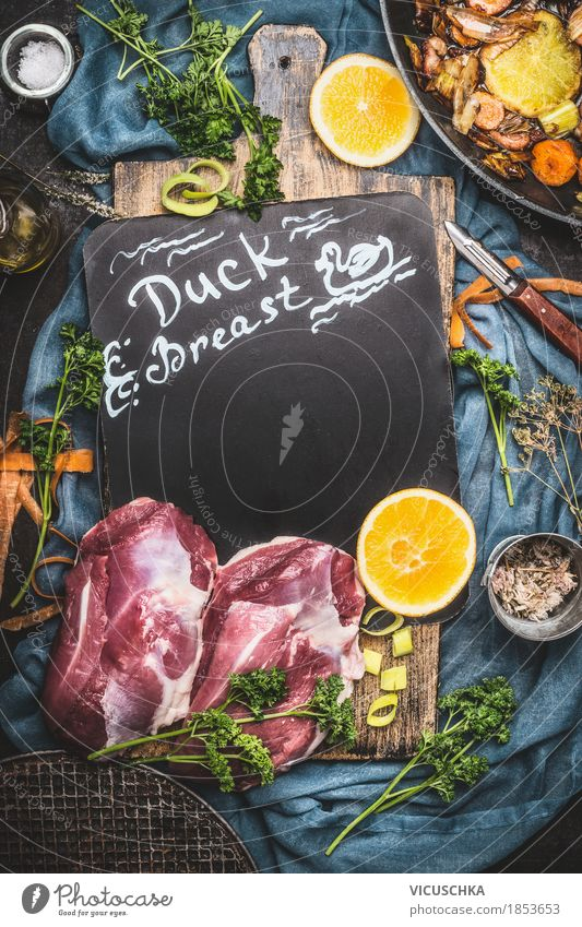 Prepare roast duck breast Food Meat Vegetable Orange Herbs and spices Cooking oil Nutrition Lunch Banquet Organic produce Crockery Style Design Table Kitchen