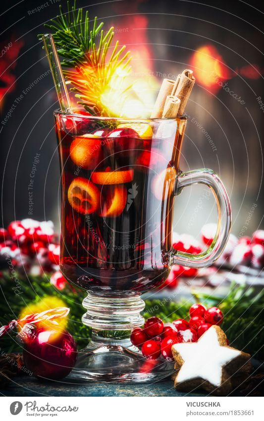 Glass of traditional mulled wine with Christmas decoration Fruit Herbs and spices Beverage Hot drink Mulled wine Cup Style Design Joy Winter Table