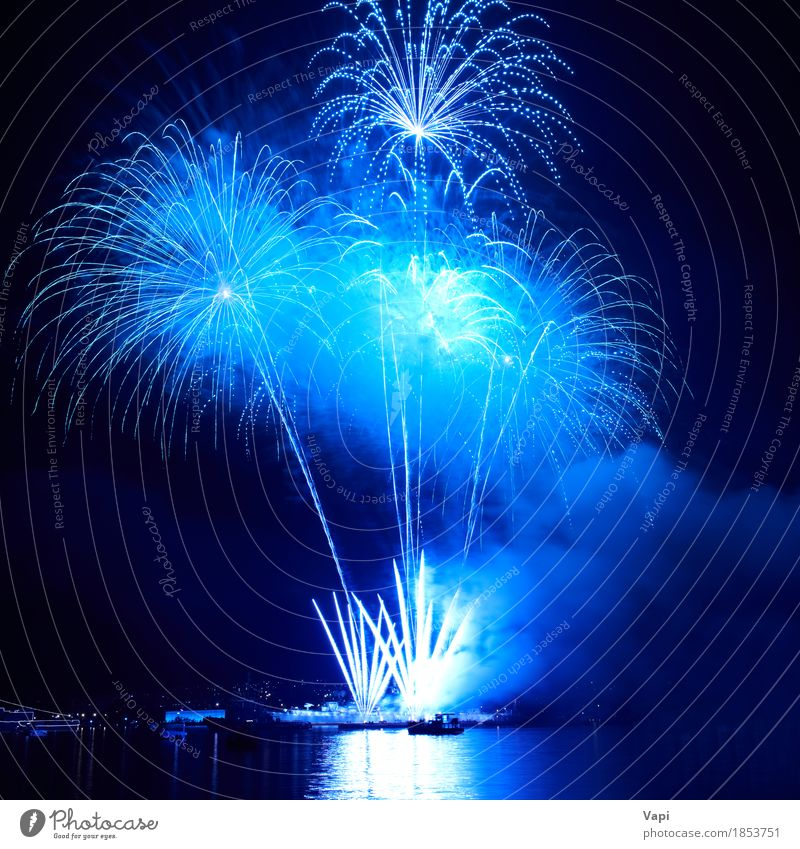Blue colorful fireworks on the black sky Sky Christmas & Advent Colour Water White Joy Dark Black Art Freedom Feasts & Celebrations Party Lake Bright River