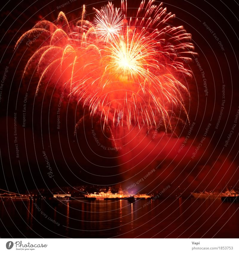 Red fireworks on the black sky Sky Christmas & Advent Colour Water White Red Joy Dark Black Yellow Art Freedom Feasts & Celebrations Party Lake Orange