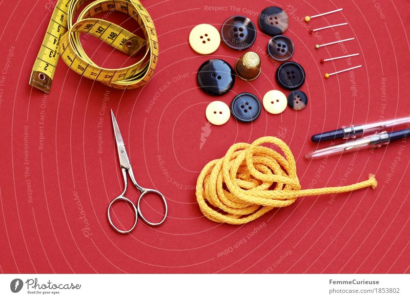 Sewing_1853802 Fashion Creativity Tailoring Make Tape measure Scissors Sewing needle String Yellow Buttons Brown Pin Still Life Red Neutral Background Measure