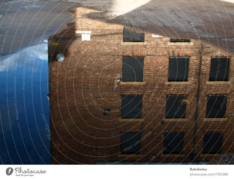 Water Sky City House (Residential Structure) Clouds Window Reflection Building Architecture Signs and labeling Facade Factory Asphalt Arrow Brick