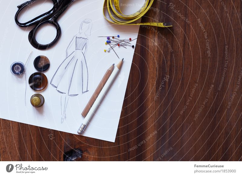 Fashion Design Leisure and hobbies Creativity Clothing Paper Planning Dress Draw Still Life Make Skirt Drawing Wooden table Conceptual design Buttons