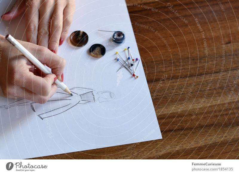 Hand Fashion Design Leisure and hobbies Creativity Paper Planning Dress Draw Make Skirt Drawing Wooden table Sewing thread Conceptual design Buttons