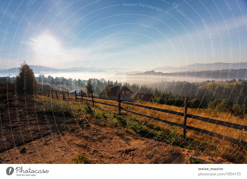 Sunny and foggy morning in Carpathian mountains Sky Nature Vacation & Travel Blue White Sun Landscape Clouds House (Residential Structure) Far-off places Forest Mountain Autumn Tourism Weather Fog