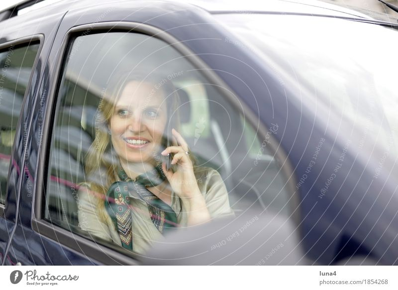 busy Business To talk Telephone Cellphone PDA Technology Feminine Woman Adults 1 Human being 30 - 45 years Motoring Vehicle Car Blonde Laughter