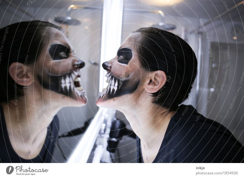 show teeth Lifestyle Leisure and hobbies Mirror Bathroom Carnival Hallowe'en Woman Adults Face 1 Human being Stage make-up Death's head Grimace Mask Scream