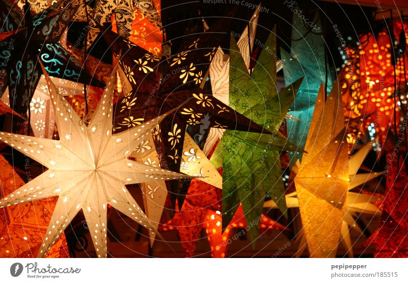 starry sky Work of art Stars Accessory Gold Hang Exotic Glittering Beautiful Thorny Multicoloured Yellow Red Close-up Deserted Light Reflection