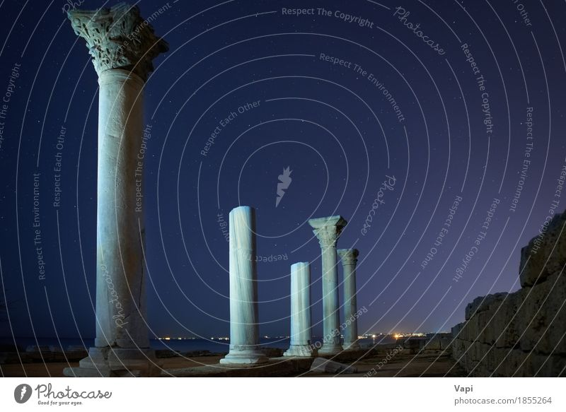 Ruins of ancient city columns under blue night sky Vacation & Travel Tourism Trip Sightseeing City trip Sculpture Architecture Landscape Sky Clouds Night sky