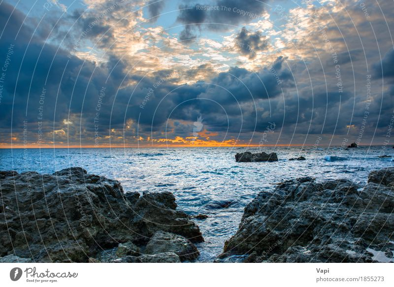 Sea landscape with bad weather, sunset and rocks Sky Nature Vacation & Travel Blue Colour Summer Water White Ocean Landscape Red Clouds Beach Black Environment Yellow
