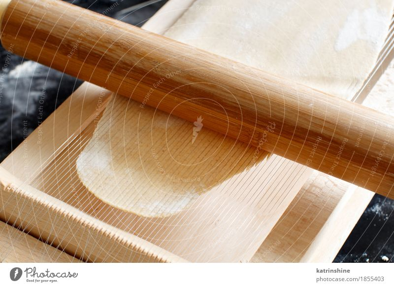 Making spaghetti alla chitarra with a tool Dough Baked goods Nutrition Italian Food Table Kitchen Tool Guitar Make Dark Fresh Tradition Ingredients manual